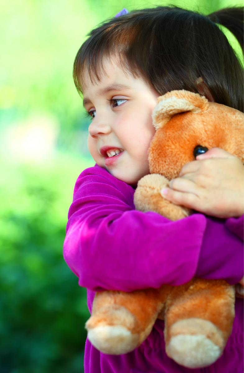 girl hugging a teddy