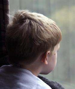 little boy looking out of window