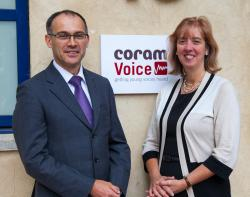 Carol Homden and Andrew Radford with Voice logo
