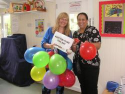 Coram staff with balloons