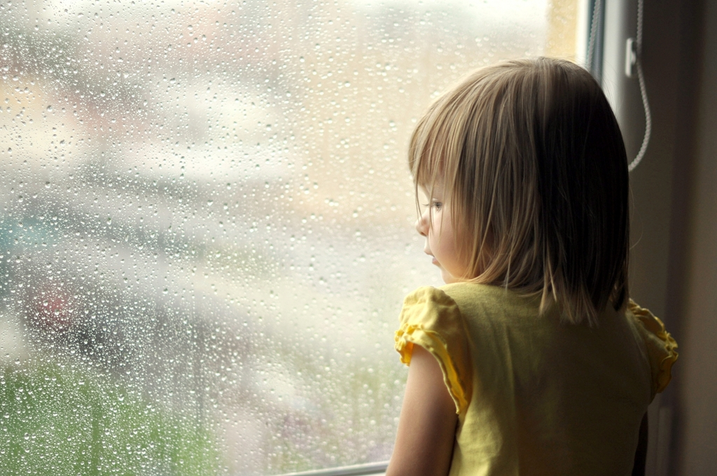 Little girl looking out of the window