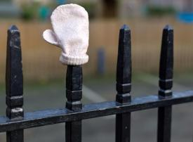 Mitten on railings