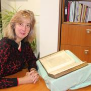 Coram CEO Carol Homden with Thomas Coram's prayer book