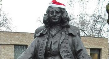Thomas Coram statue in the heart of London wearing a santa hat