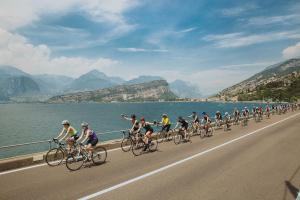 pedELLE ladies cycling for Coram through Spain on road next to sea