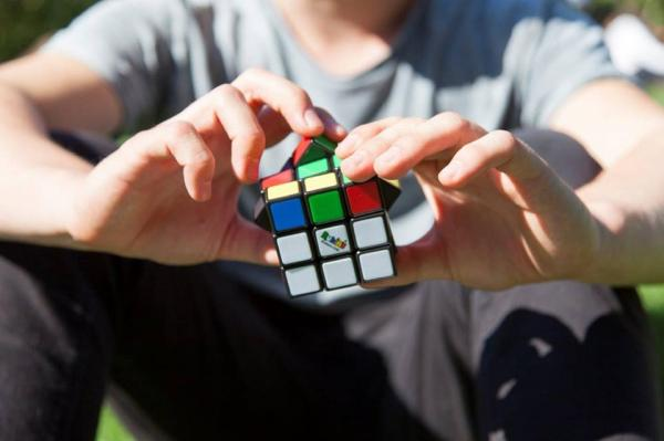 Child with Rubik's Cube