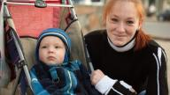 Mother with her son in a pushchair