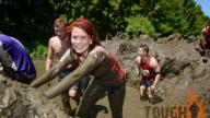 Mud covered Tough Mudder participants