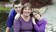 Adoptive mum with teenage adopted son and younger adopted daughter