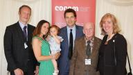 One of the youngest children adopted through Coram with her parents, The Ministe