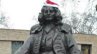 Captain Coram statue wearing a santa hat