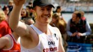 Dan French smiling at the Coram team during the London Marathon