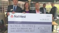 Carol Homden collecting the check from Broadgate