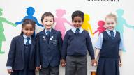 School children standing outside Coram Life Education mobile classroom