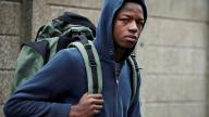 Young homeless teen with his rucksack