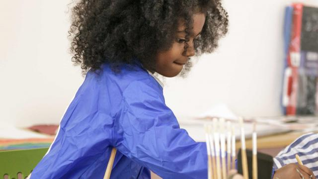 Young girl participating in Coram's Creative Therapies