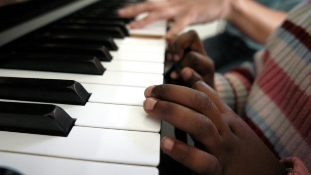 child's hand on piano