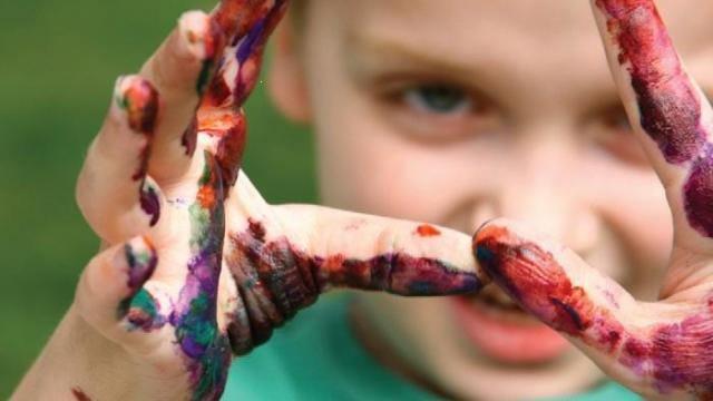 Young boy enjoys expressing himself with paints