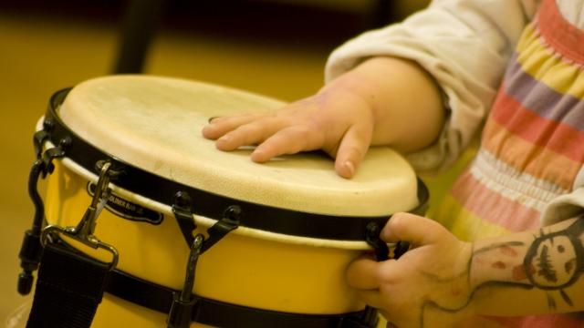 Child's hands on drums